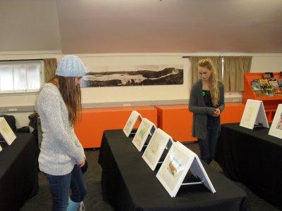Children looking at Muka Prints, Rotorua Museum, 2014