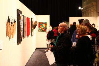 Visitors view Rotorua Museum Art Awards 2017 Exhibition of Finalists. Photograph by Natascha Hartzuiker
