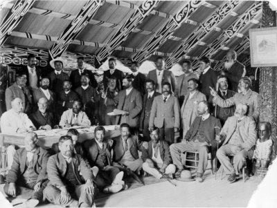 Group of men, possibly at a Land Court meeting, inside Tamatekapua meeting house at Ohinemutu. Ref: 1/2-043266-F. Alexander Turnbull Library, Wellington, New Zealand.
